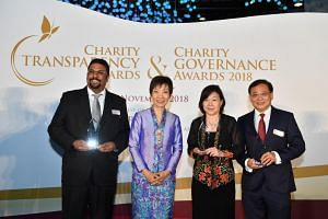 Minister for Culture, Community and Youth Grace Fu with Club Rainbow president Sashikumar Ganapathy, Sata CommHealth chairman Theresa Goh and Mindset Care company secretary Jeffery Tan at the Charity Transparency and Governance Awards.