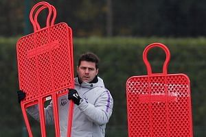 Tottenham manager Mauricio Pochettino (left) admits that Arsenal are a different kettle of fish under Unai Emery (above), who has instilled a sense of tactical discipline that was often missing under Arsene Wenger.