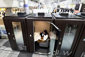 Newly installed private offices are seen inside the JR Shinagawa Station.