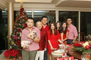 (From left) Berrand Peh, 27, holding the family' dog, Duke; Mark Leong, 91; Adrian Peh, 57; Susan Peh, 56; Desiree Peh, 24; Melissa Peh, 28; and Melissa's fiance, Alvin Soon, 30.
