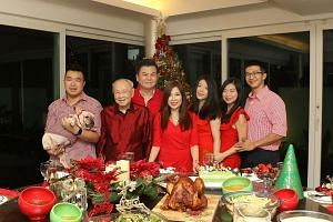 The Pehs' pine tree is always a live one and ordered two months in advance. Stuffed toys from the children's childhood are placed between the leaves. For lawyer Susan Peh (fourth from left), dinner on Christmas Eve is always a cosy one - with her hus