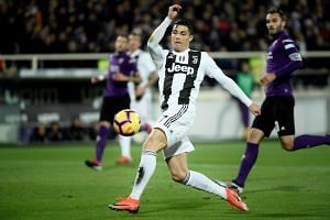Juventus's striker Cristiano Ronaldo from Portugal kicks the ball during the Italian Serie A football match Fiorentina vs Juventus on Dec 1, 2018 at the Artemio Franchi Stadium in Florence.