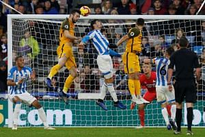 Brighton's Shane Duffy scores their first goal.