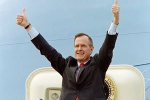 In this file photo taken on March 5, 1992, then US President George H.W. Bush acknowledges the crowd gathered at Columbia Metropolitan Airport with a thumbs-up as he boards Air Force One. He served a term in the White House from 1989 to 1993.