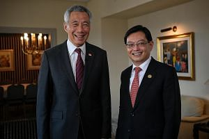 Prime Minister Lee Hsien Loong and Finance Minister Heng Swee Keat at the media wrap after the G-20 Leaders' Summit in Buenos Aires on Saturday. PM Lee warned that if the US and China do not handle their differences well, they may face a prolonged pe
