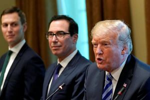 US President Donald Trump, seated with adviser Jared Kushner (left) and Treasury Secretary Steve Mnuchin (centre), at a meeting at the White House in Washington, US, on Sept 5, 2018.