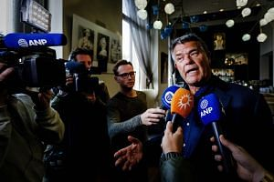 Emile Ratelband, 69, speaking with journalists on Dec 3, 2018, in Amsterdam, following the court's ruling regarding his legal bid to slash 20 years off his age.