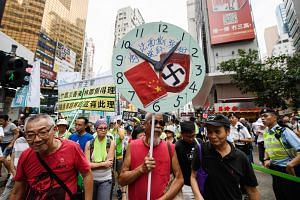 Protesters in Hong Kong taking part in an annual National Day pro-democracy rally on Oct 1. The Hong Kong government's decision to in effect expel Mr Victor Mallet, the Asia news editor for the Financial Times, has finally pushed some representatives