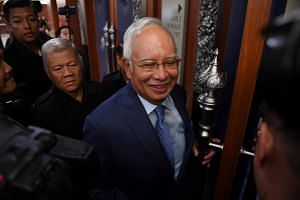 File photo of former Malaysian prime minister Najib Razak arriving at the Parliament House in Kuala Lumpur on Oct 15, 2018.