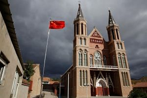 The Chinese national flag flies in front of a Catholic underground church in the village of Huangtuang, in Hebei province, China, on Sept 30, 2018.