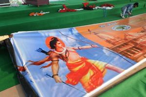 Indian workers prepare hoardings with pictures of Lord Rama on it ahead of a rally called Vishal Dharm Sabha to be held by Vishwa Hindu Parishad (VHP), in New Delhi.