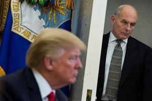 White House Chief of Staff John Kelly looks on as US President Donald Trump meets North Korean defectors in the Oval Office in Washington on Feb 2, 2018.