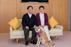 Japan's Crown Princess Masako and her husband Crown Prince Naruhito pose for a photograph with their pet dog Yuri at Togu Palace in Tokyo on Dec 4, 2018.