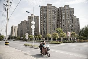 A high-rise residential development in Shanghai. Real estate underpins China's US$1.4 trillion (S$1.9 trillion) non-performing loan market, accounting for up to 80 per cent of debt in portfolios sold, said PricewaterhouseCoopers.