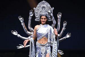 Miss Nepal, Manita Devkota, walks on stage during the 2018 Miss Universe national costume presentation in Chonburi province on Dec 10, 2018.