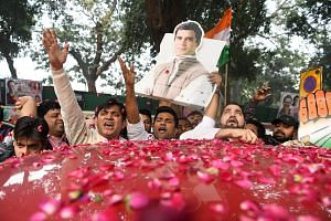 Supporters carrying a cutout of Congress party leader Rahul Gandhi, for whom the result in the latest polls has been a major boost. He had been struggling to prove his mettle in politics, suffering repeated electoral defeats in previous state electio