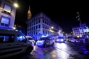 Rescue vehicles parked near the Christmas market where a deadly shooting took place in Strasbourg, France, on Dec 12, 2018.