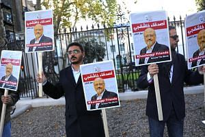 People protest against the killing of journalist Jamal Khashoggi in Turkey outside the Saudi Arabian Embassy in London on Oct 26, 2018.