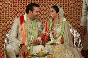 Bride Isha Ambani, the daughter of the chairman of Reliance Industries Mukesh Ambani, and groom Anand Piramal, heir to a real-estate and pharmaceutical business, after they got married in Mumbai, on Dec 12, 2018.