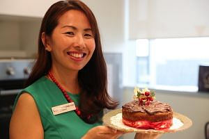 Principal dietitian Catherine Koh, from Alexandra Hospital, prepares healthy Christmas recipes, including the Marble Castella Cake pictured, which was baked without butter.