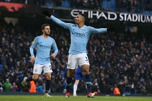 Manchester City's Gabriel Jesus (right) celebrates scoring during the English Premier League match against Everton at the Etihad Stadium in Manchester on Dec 15, 2018.
