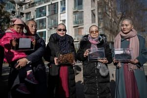 (From left) Yuan Shanshan, Liu Ermin, Wang Qiaoling and Li Wenzu shaved their heads to protest the detention of their husbands, who were detained during the 709 crackdown, in Beijing, on Dec 17, 2018.