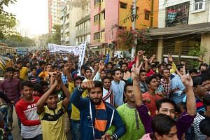 Supporters of Bangladesh Awami League march in the street as they take part in a general election campaign procession in Dhaka, Bangladesh, on Dec 10, 2018.