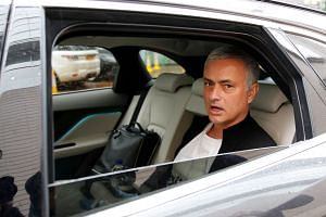 Mourinho is driven away from his accommodation after leaving his job as Manchester United's manager.