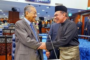 Malaysian Prime Minister Mahathir Mohamad (left) will step down to allow Mr Anwar Ibrahim to take over in about two years, according to a deal struck before the May 9 general election, but it is an open secret that the timeline and exact manner of ho