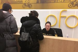 Bike-sharing service Ofo users request their deposit refunds at the company's headquarters in Beijing, China on Dec 17, 2018.