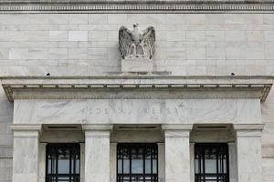 Fed officials maintained a generally upbeat view of the economy even as they trimmed their own projections for future rate increases.
