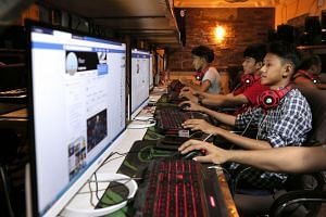 Myanmar teens browsing Facebook at an Internet shop in Yangon. Facebook has removed hundreds of additional pages and accounts in Myanmar with hidden links to the military, the platform said yesterday, as the company scrambles to respond to criticism