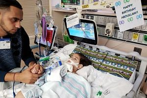 Two-year-old Abdullah Hassan, who suffers from a rare genetic brain condition and is on life support at UCSF Benioff Children's Hospital in Oakland, with his father Ali, on Dec 16, 2018.