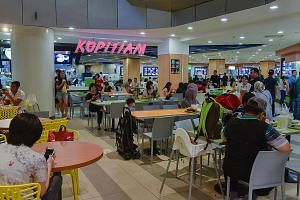 The Kopitiam foodcourt in VivoCity. NTUC Enterprise's promise to make affordable food more widely accessible with its expanded stable of outlets may be a tall order, say observers. The price of food, they say, is tied closely to its biggest operating