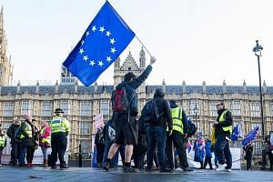An anti-Brexit demonstrator waving a European Union flag outside the Houses of Parliament in London on Wednesday.