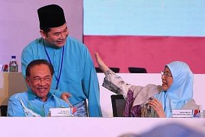 Parti Keadilan Rakyat senior politician Rafizi Ramli (centre) with its president, Datuk Seri Anwar Ibrahim, and Deputy Prime Minister Wan Azizah Wan Ismail at the party's annual convention in Shah Alam last month. Mr Rafizi said the way forward for t