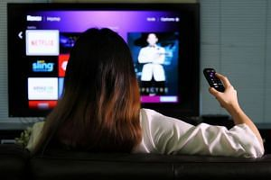 Households are urged to make the switch to digital TV before analogue TV transmissions cease from Jan 2. PHOTO: ST FILE