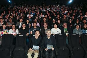 Home-grown director Boo Junfeng (front row, left) and Roma director Alfonso Cuaron (right) at a screening of the film at Filmgarde Bugis+ on Thursday.