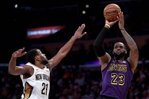 LeBron James finished with 22 points, 12 rebounds and 14 assists as the host Los Angeles Lakers turned back the New Orleans Pelicans 112-104 on Dec 21, 2018.