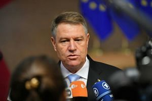 Romania's President Klaus Werner Iohannis arrives in Brussels during the second day of a European Summit aimed at discussing the Brexit deal, the long-term budget and the single market, on Dec 14, 2018.