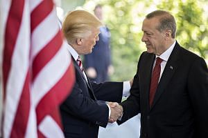 US President Donald Trump greeting his Turkish counterpart Recep Tayyip Erdogan at the West Wing of the White House in May last year. The two leaders had a lengthy phone call earlier this month.