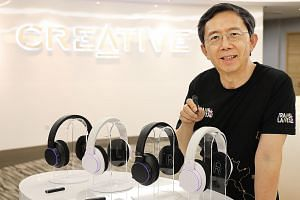 Creative Technologies founder and chief executive Sim Wong Hoo with the new Super X-Fi products.