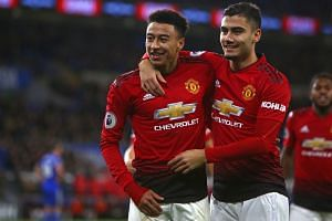 United's Jesse Lingard (left) celebrates with Andreas Pereira after scoring their fifth goal.