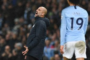 Manchester City's Spanish manager Pep Guardiola reacts on the touchline during the match.
