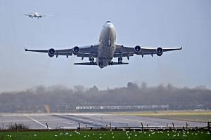 An aeroplane lands at Gatwick Airport, after the airport reopened to flights following its forced closure because of drone activity, in Gatwick, Britain, on Dec 21, 2018.