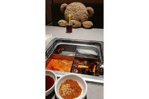 Solo diners at Haidilao, a Chinese hotpot chain, are seated with a teddy bear to keep them company.