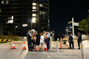 Police check the unit numbers of the residents after an inspection of the Opal Tower by firefighters and engineers in Sydney on Dec 25, 2018.