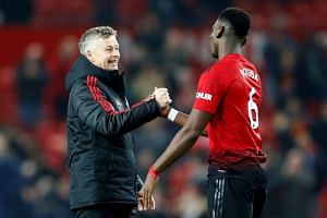 Manchester United's Paul Pogba and interim manager Ole Gunnar Solskjaer after the match.