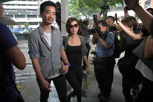 Former City Harvest Church finance manager Serina Wee, accompanied by her husband Kenny Low, arriving at the State Courts to begin her jail term on April 21, 2017. Ms Wee was released from custody on Dec 21, 2018.