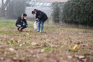 Forensic investigators work in an area near a street where the Inter Milan soccer fan died in Milan, Italy, on Dec 27, 2018.